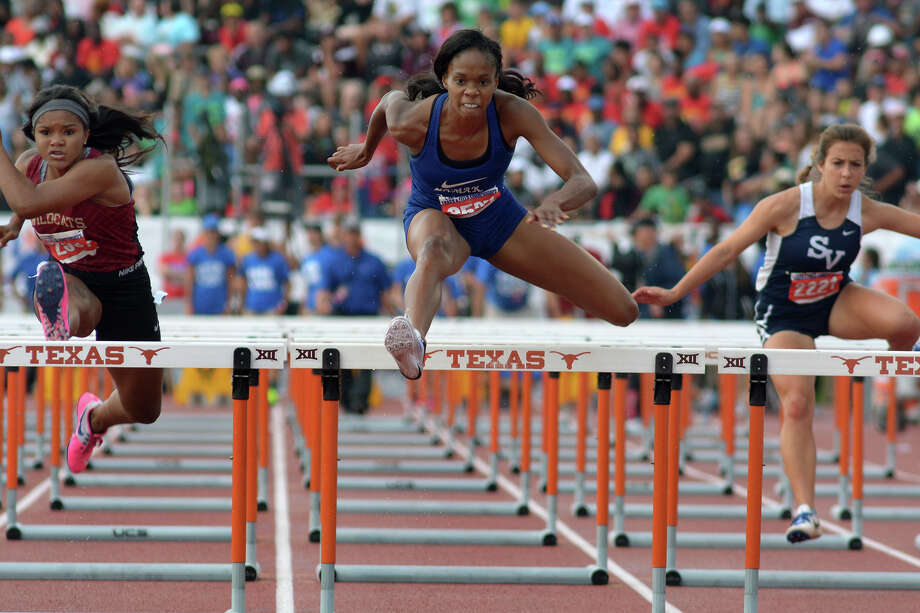 Houston Lamar's Milan Young, center, clears the last hurdle ahead of Cy-Woods' Kennedy Baile, left, during the Conference 6A Girls 100 Meter Hurdles at the UIL Track & Field Championships at Mike R. Meyers Stadium on the campus of The University of Texas at Austin on Saturday, May 14, 2016. (Photo by Jerry Baker/Freelance) Photo: Jerry Baker, Freelance
