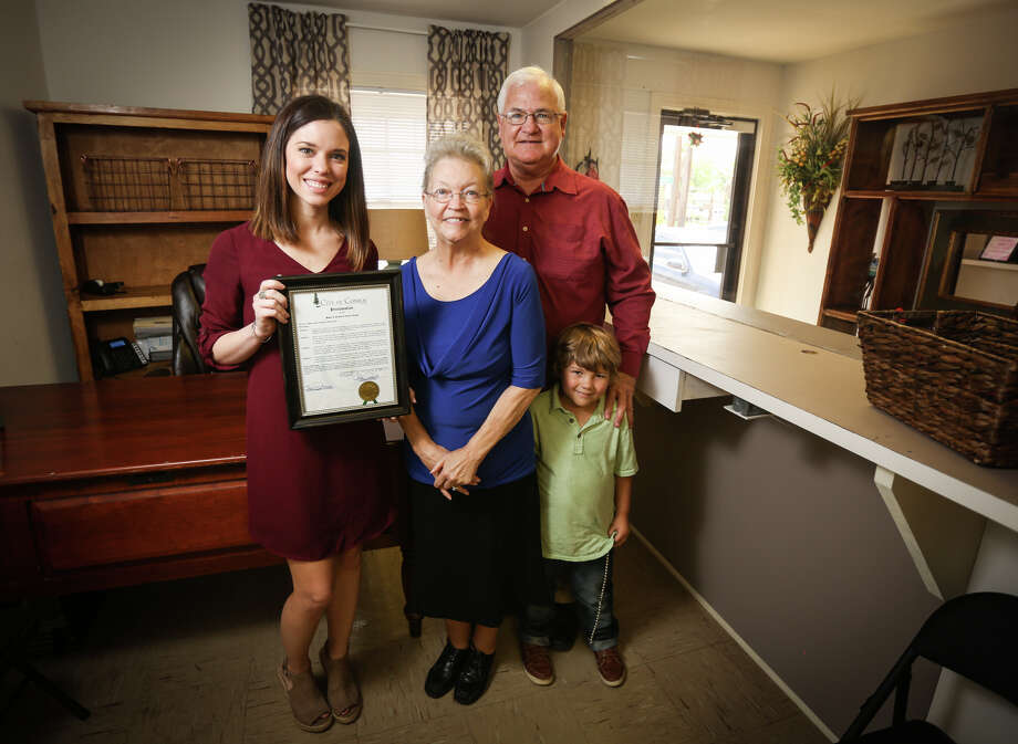 From the left: general manager Katelyn Langley, of Conroe's Maids and Moore Cleaning Services, Brenda Yuengel, who is fighting colon cancer, her husband Bob and her 5-year-old grandson Peyton pose for a portrait on Friday, April 14, 2017, at the Maids and Moore Cleaning Services in Conroe. Langley's business has joined the nonprofit Cleaning For A Reason to provide Brenda with free housecleaning services, freeing her to focus more on her health and treatments. Photo: Michael Minasi, Staff Photographer / © 2017 Houston Chronicle