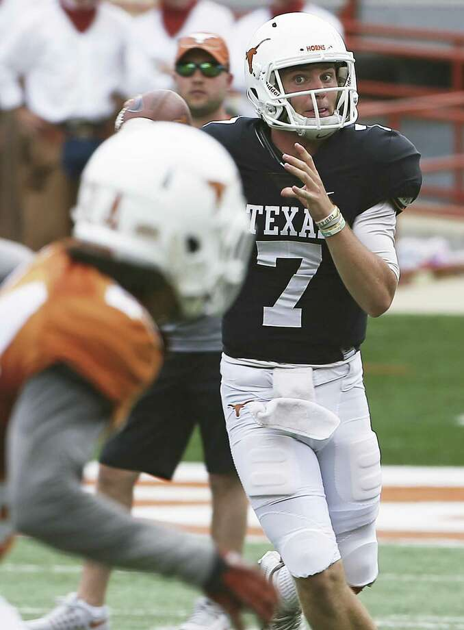 Quarterback Shane Buechele fakes a throw as the Texas Longhorns play their Orange-White spring game on April 15, 2017. Photo: Tom Reel, Staff / San Antonio Express-News / 2017 SAN ANTONIO EXPRESS-NEWS