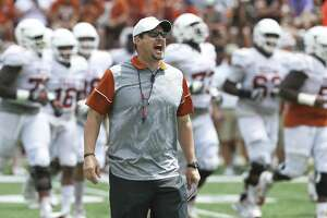 Head coach Tom Herman exhorts his players to move oonto the field quickly as the Texas Longhorns play their Orange-White spring game on April 15, 2017.