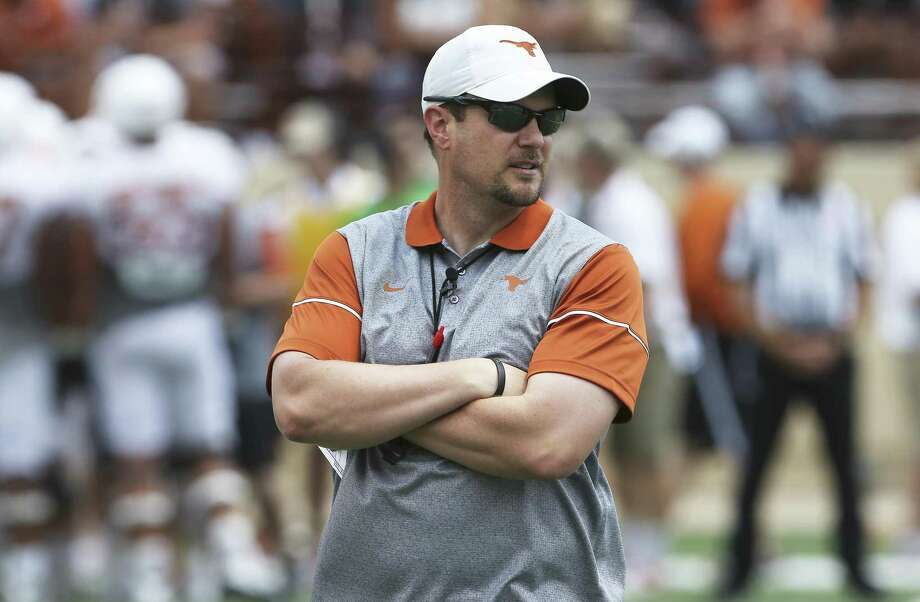 Coach Tom Herman watches his players warm up before the Longhorns' Orange-White spring game on April 15, 2017, in Austin. Photo: Tom Reel /San Antonio Express-News / 2017 SAN ANTONIO EXPRESS-NEWS