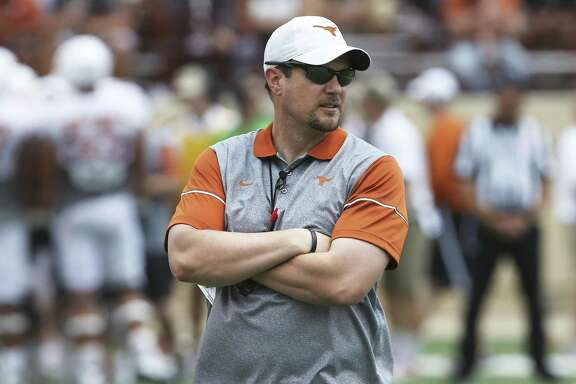 Coach Tom Herman watches his players warm up before the Longhorns' Orange-White spring game on April 15, 2017, in Austin.