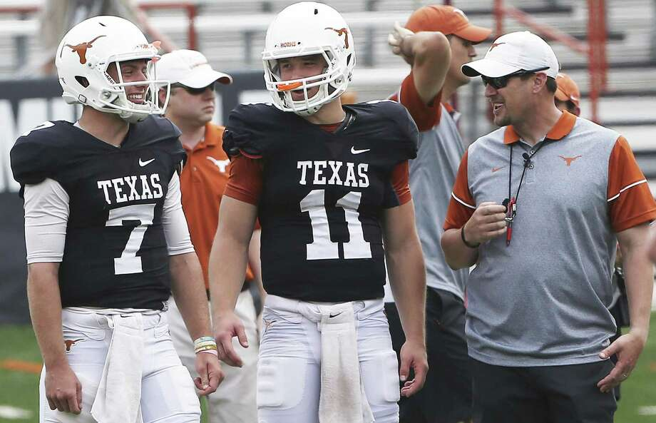 Quarterbacks Shane Buechele (7) and Sam Ehlinger (11) share a laugh with coach Tom Herman as the Texas Longhorns play their spring game on April 15, 2017, in Austin. Photo: Tom Reel /San Antonio Express-News / 2017 SAN ANTONIO EXPRESS-NEWS