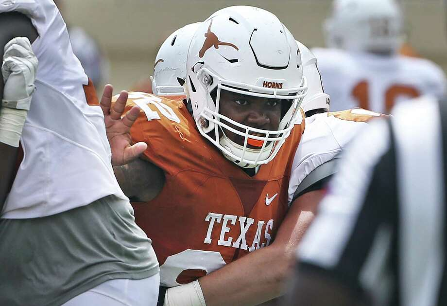 Jordan Elliott pushes his way through the middle trying to get to the quarterback as the Texas Longhorns play their Orange-White spring game on April 15, 2017. Photo: Tom Reel, Staff / San Antonio Express-News / 2017 SAN ANTONIO EXPRESS-NEWS