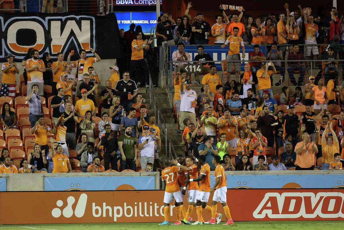 Houston Dynamo players and fans celebrate their second goal during the first half of the game at BBVA Compass Stadium Saturday, April 15, 2017, in Houston.