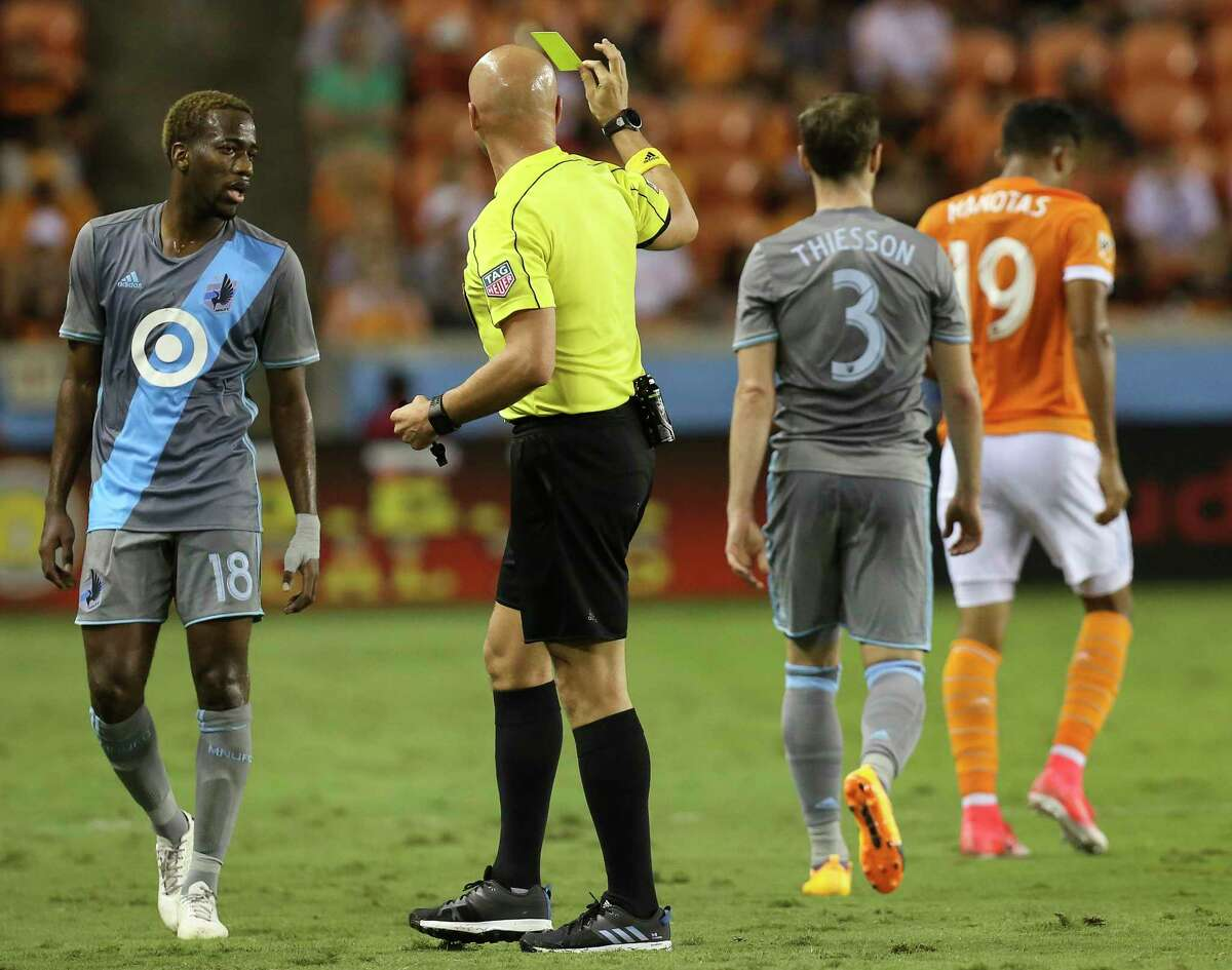 Minnesota United midfielder Jerome Thiesson (3) receives a yellow card during the first half of the game at BBVA Compass Stadium Saturday, April 15, 2017, in Houston.