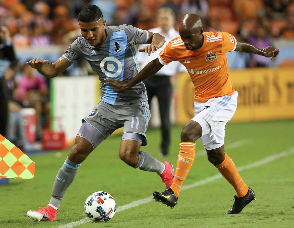 Houston Dynamo midfielder DaMarcus Beasley (7) guards Minnesota United midfielder Johan Venegas (11) as Venegas is moving the ball down the field during the first half of the game at BBVA Compass Stadium Saturday, April 15, 2017, in Houston.