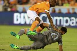 Houston Dynamo defender Adolfo Machado (3) collides with Minnesota United forward Christian Ramirez (21) at the penalty area during the first half of the game at BBVA Compass Stadium Saturday, April 15, 2017, in Houston.