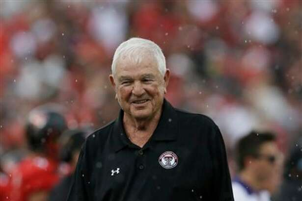 This Sept. 26, 2015 photo shows former Texas Tech football coach Spike Dykes walking the field during the first half of an NCAA college football game in Lubbock, Texas. Dykes, the folksy West Texas native who led Texas Tech to its only Cotton Bowl when that game was reserved for the Southwest Conference champion, has died, Monday, April 10, 2017. He was 79. (AP Photo/LM Otero)