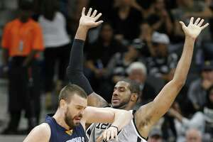 Memphis GrizzliesÕ Marc Gasol looks for room around San Antonio Spurs' LaMarcus Aldridge during first half action of Game 1 in the first round of the Western Conference playoffs held Saturday April 15, 2017 at the AT&T Center.