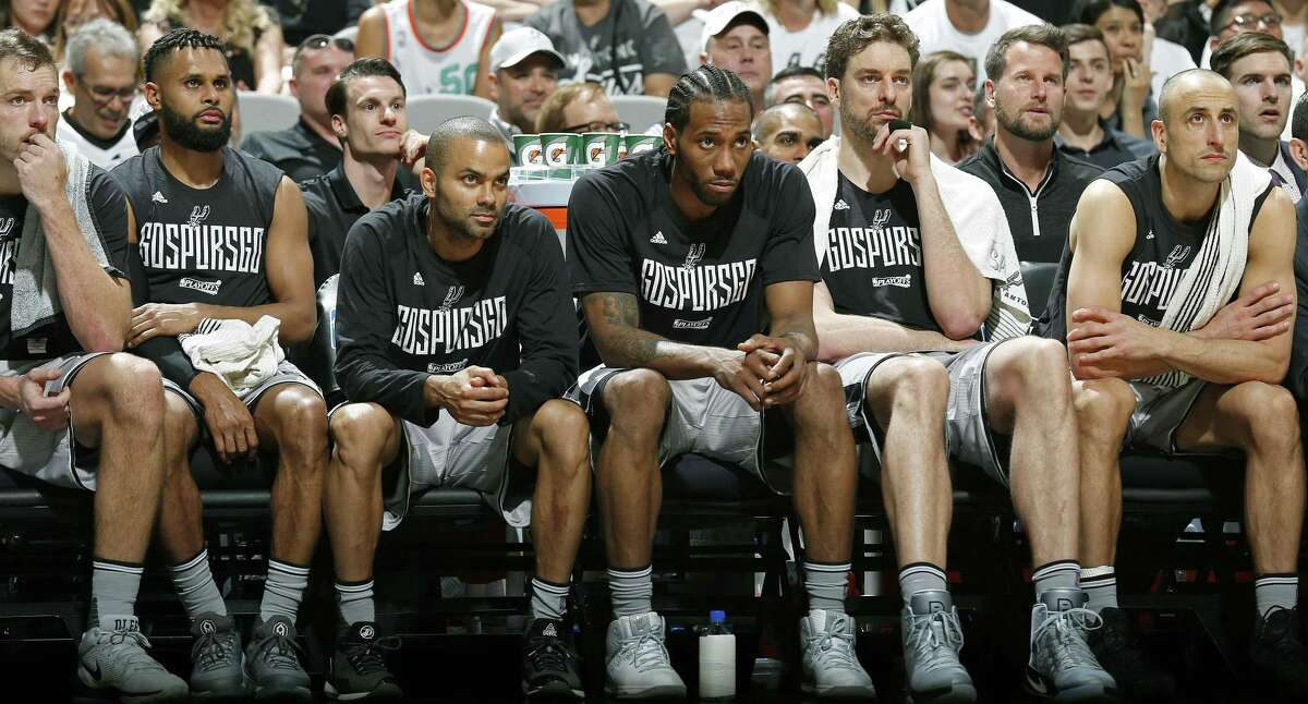San Antonio Spurs' David Lee (from left), Patty Mills, Tony Parker, Kawhi Leonard, Pau Gasol, and Manu Ginobili watch second half action of Game 1 in the first round of the Western Conference playoffs against the Memphis Grizzlies from the bench Saturday April 15, 2017 at the AT&T Center. The Spurs won 111-82.