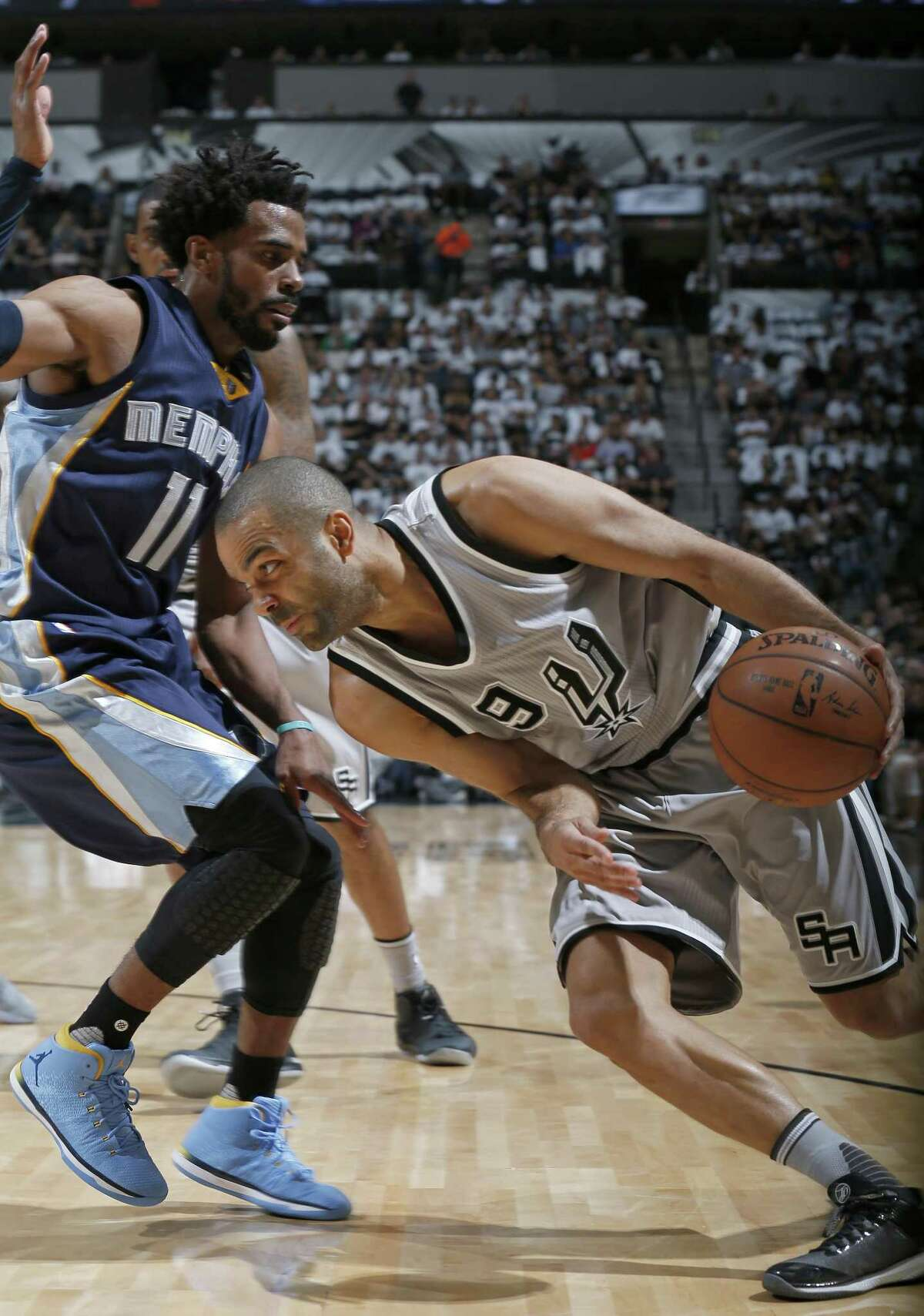 San Antonio Spurs' Tony Parker looks for room around Memphis Grizzlies?• Mike Conley during first half action of Game 1 in the first round of the Western Conference playoffs held Saturday April 15, 2017 at the AT&T Center.