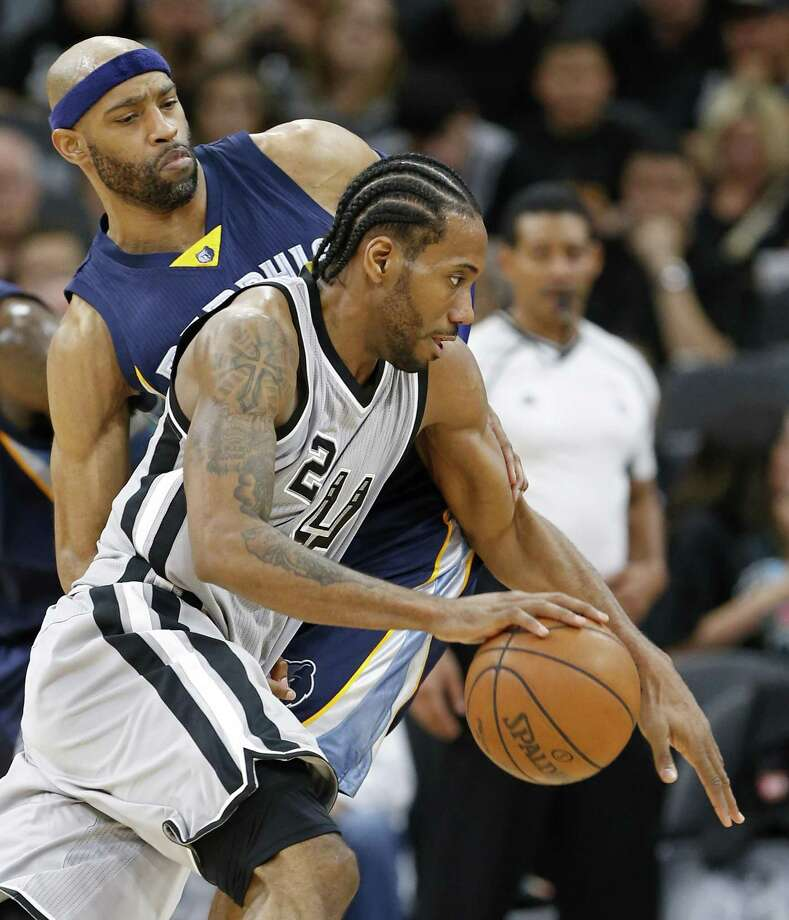 San Antonio Spurs' Kawhi Leonard looks for room around Memphis GrizzliesÕ Vince Carter during second half action of Game 1 in the first round of the Western Conference playoffs held Saturday April 15, 2017 at the AT&T Center. The Spurs won 111-82. Photo: Edward A. Ornelas, Staff / San Antonio Express-News / © 2017 San Antonio Express-News