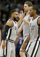 San Antonio Spurs' Patty Mills celebrates with teammates Pau Gasol, and Kawhi Leonard after making a 3-pointer during second half action of Game 1 in the first round of the Western Conference playoffs against the Memphis Grizzlies Saturday April 15, 2017 at the AT&T Center. The Spurs won 111-82.