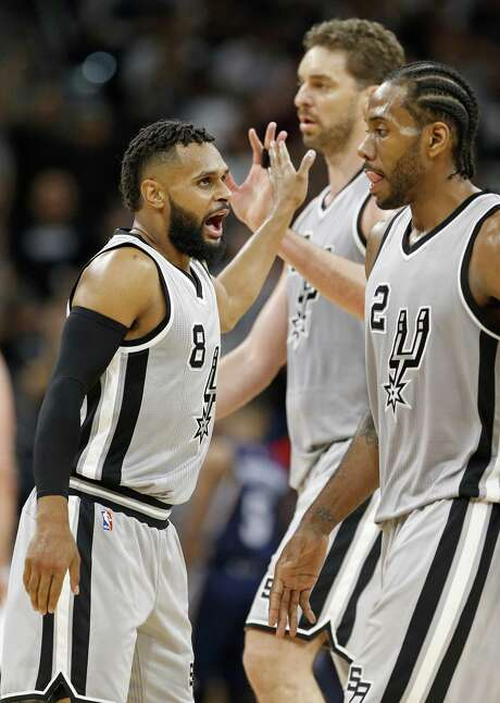 San Antonio Spurs' Patty Mills celebrates with teammates Pau Gasol, and Kawhi Leonard after making a 3-pointer during second half action of Game 1 in the first round of the Western Conference playoffs against the Memphis Grizzlies Saturday April 15, 2017 at the AT&T Center. The Spurs won 111-82. Photo: Edward A. Ornelas, Staff / San Antonio Express-News / © 2017 San Antonio Express-News