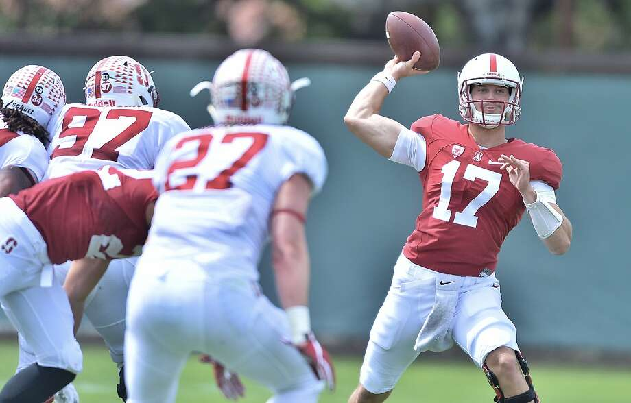Quarterback Ryan Burns passes during Stanford's Cardinal and White spring game. Burns went 10-for-15 passing, giving him a boost in the backup QB race. Photo: JOHN TODD   / Stanford  Athletics