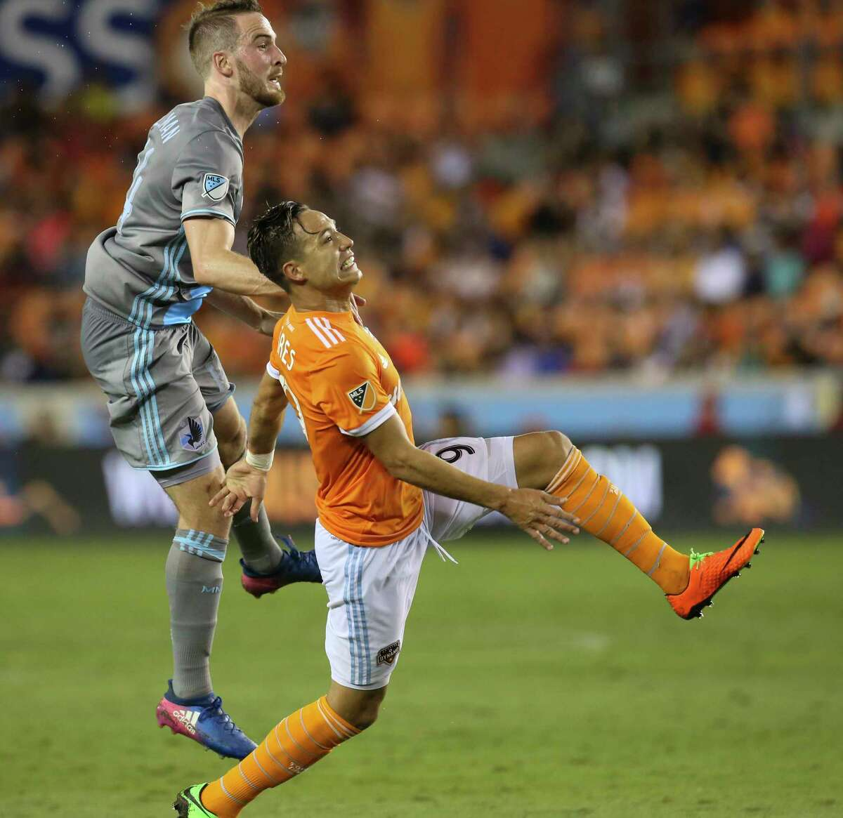 Houston Dynamo forward Erick Torres (9) and Minnesota United defender Brent Kallman (14) battle for a header during the second half of the game at BBVA Compass Stadium Saturday, April 15, 2017, in Houston.