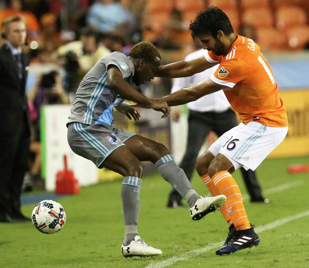 Houston Dynamo defender Kevin Garcia (16) battles with Minnesota United midfielder Kevin Molino (18) along the sideline during the second half of the game at BBVA Compass Stadium Saturday, April 15, 2017, in Houston.