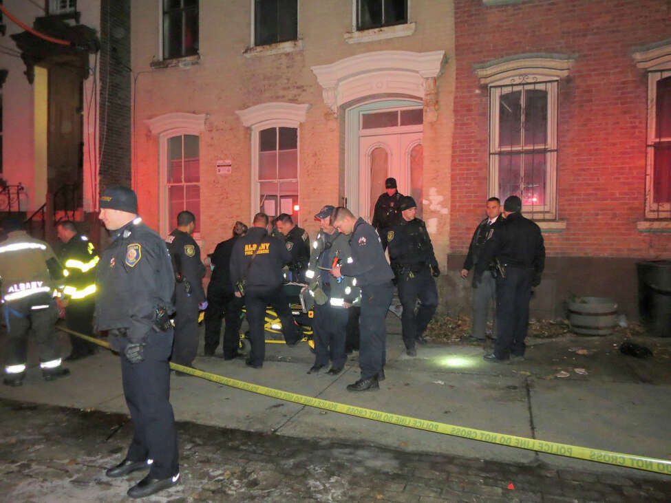Police and first responders at the scene where a man was shot in the leg on the 300 block of Clinton Avenue in Albany on Friday, December 23, 2016. (Tom Heffernan Sr./Special to the Times Union)