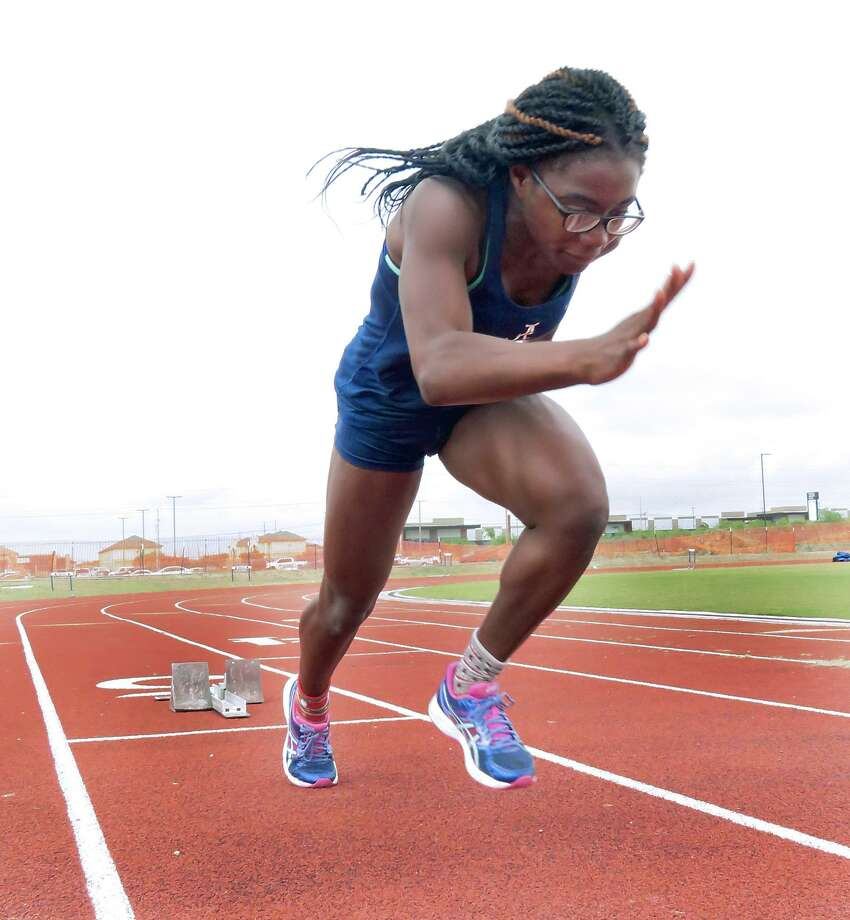 Alexander's Cynthia Emeremnu won a title in the 100-meter dash at the T.A.A.F. Games of Texas State Track and Field Meet Sunday at McAllen Veterans Memorial Stadium. Photo: Cuate Santos /Laredo Morning Times File / Laredo Morning Times