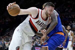 FILE - In this March 23, 2017, file photo, Portland Trail Blazers center Jusuf Nurkic, left, drives past New York Knicks center Kyle O'Quinn during the second half of an NBA basketball game in Portland, Ore. His arrival sparked the lackluster Trail Blazers and he quickly became a fan favorite in Portland. Now Rip City anxioulsy waits to see when _ and if _ big man Jusuf Nurkic will return for the playoffs.(AP Photo/Craig Mitchelldyer, File)