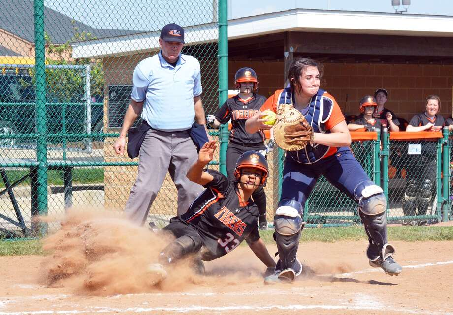 Edwardsville's Maria Smith slides into home plate during the first game of a doubleheader against Rochester on Saturday inside the District 7 Sports Complex.