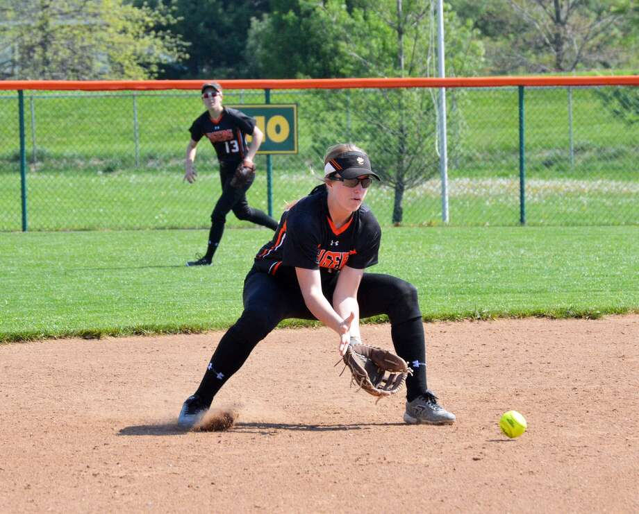 Edwardsville shortstop Anna Burke fields a ground ball during the first game.