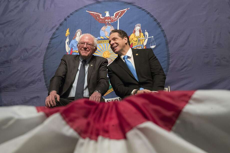 Sen. Bernie Sanders (left) and New York Gov. Andrew Cuomo appear together Jan. 3 at a community college event in New York City. Photo: Mary Altaffer, Associated Press