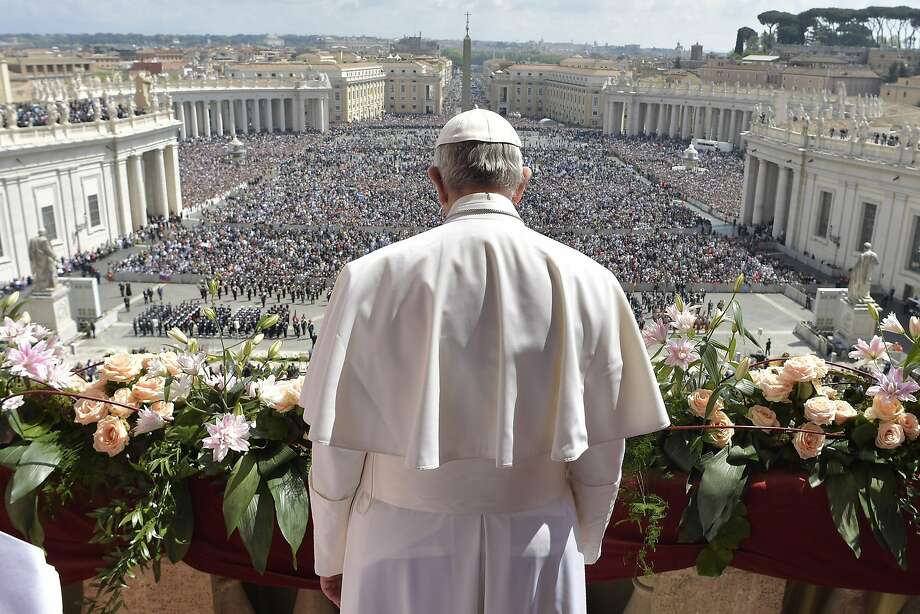 "Pope Francis greets the crowd before delivering his "" Urbi et Orbi "" Easter message from the balcony of St. Peter's Basilica at the Vatican. He condemned the sufferings caused by war. Photo: Associated Press"