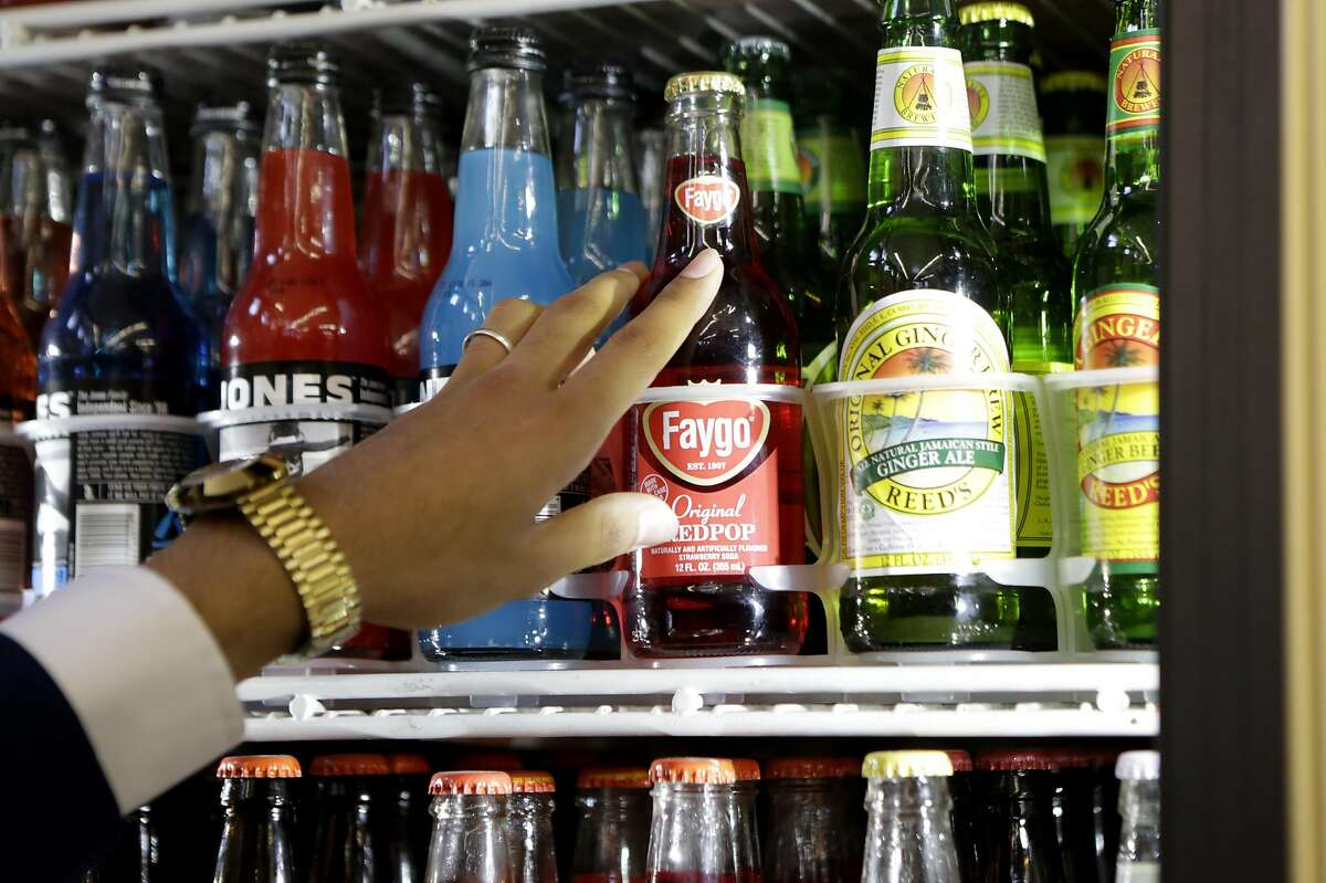 Murad Hussein counts the sodas he has in stock in Ashby Supermarket on Friday, April 14, 2017, in Berkeley, Calif.