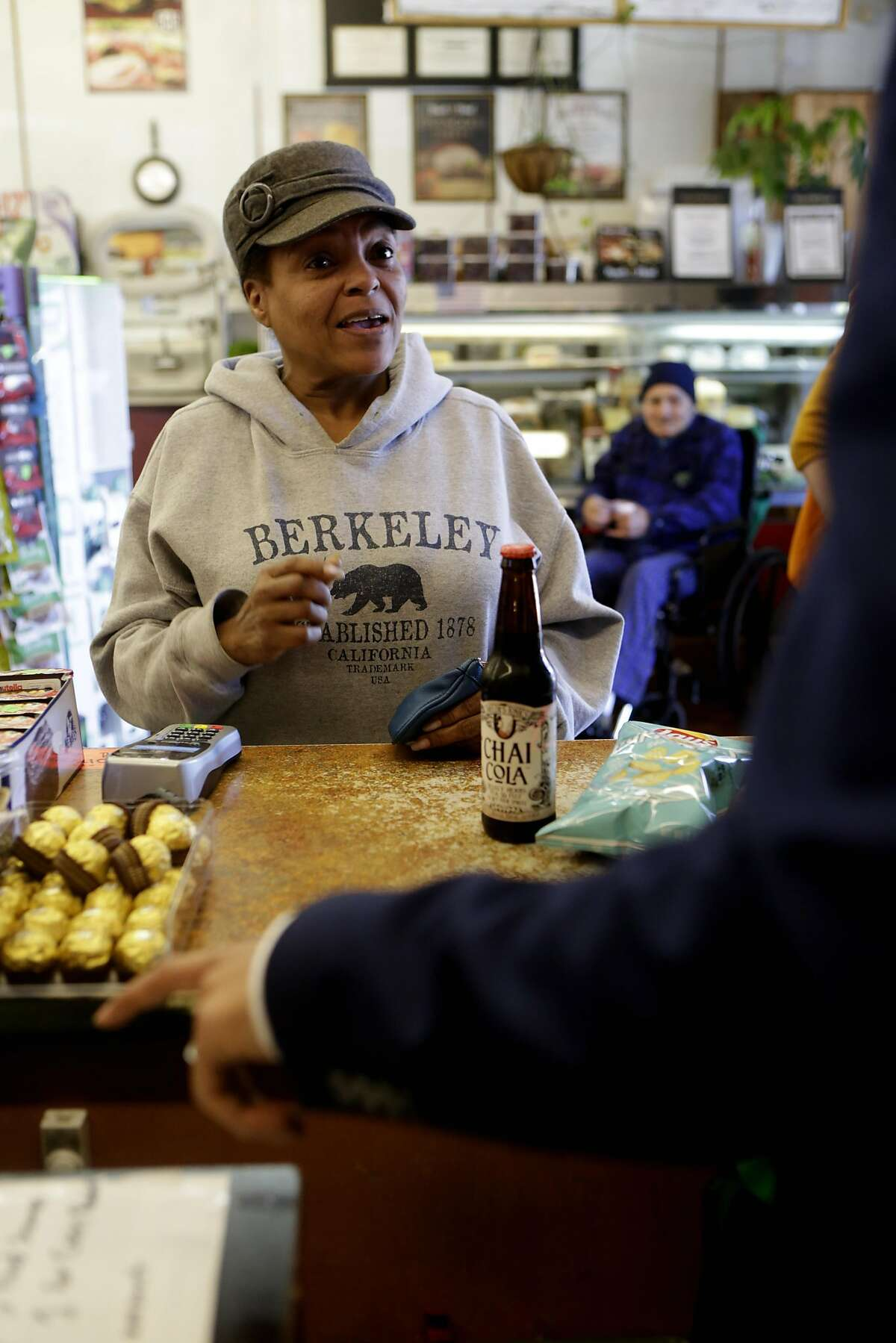 Robyn Sullivan, a regular customer at Ashby Supermarket, buys a chai cola on Friday, April 14, 2017, in Berkeley, Calif.