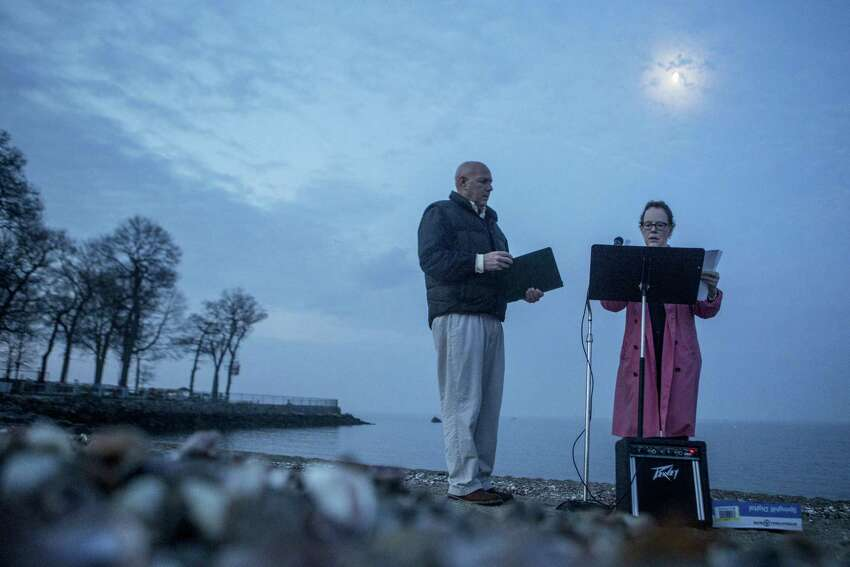 Under the moonlight before the sunrise The Rev. John Livingston from The United Church of Rowayton and the Rev. Karen Eiler from Rowayton United Methodist Church prepare for the Easter Sunrise Service at Bayley Beach on Sunday, April 16, 2017. After the service, many who attended went to the Rowayton Firehouse for Easter morning breakfast.