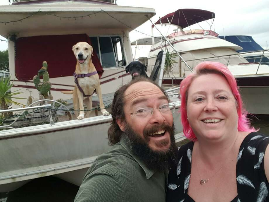 Brian Treybig and Kristina Smiley, shown with their dogs Summer and Milo, share a houseboat and a passion for acting in community theater.