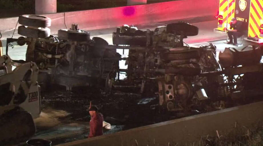 A fiery truck crash shut down portions of Southwest Freeway for hours Saturday night.A fiery truck crash shut down portions of Southwest Freeway for hours Saturday night. Photo: Metro Video