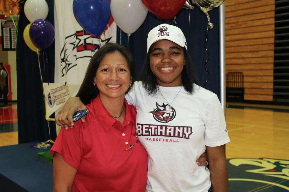 Dawson basketball player Liz Davis, shown with Lady Eagle head coach Isabel Gomez, has signed a letter of intent to play at Bethany Lutheran College. Photo: Submitted Photo