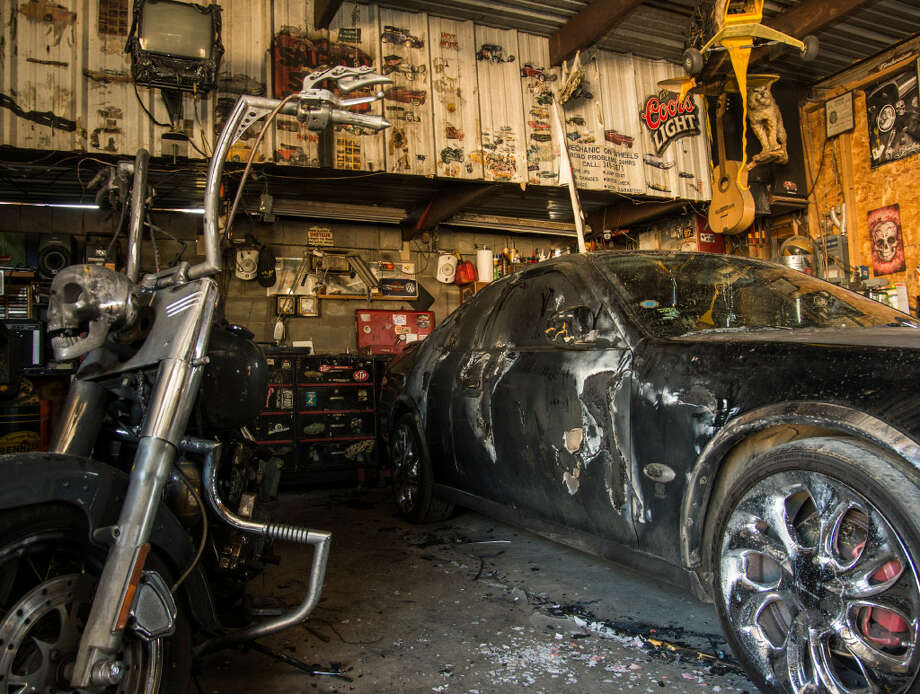 Gilbert Salgado wants to warn others of the dangers of working in a small shop after a flash fire from gas fumes and a hot light bulb burned his hand, his motorcycle, his project car and workshop recently. Photo: Tim Fischer/Reporter-Telegram