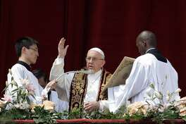 Pope Francis delivers his Urbi et Orbi (to the city and to the world) from the main balcony of St. Peter's Basilica, at the Vatican on Sunday.