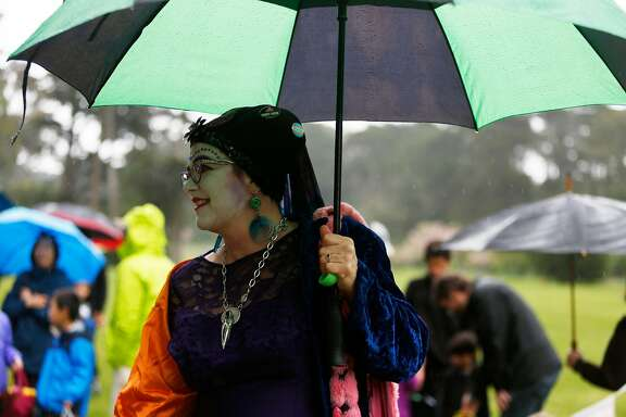 A Sister of Perpetual Indulgence stands in the rain during the annual Easter Egg Hunt in Golden Gate Park on Sunday, April 16, 2017, in San Francisco, Calif.on Sunday, April 16, 2017, in San Francisco, Calif.