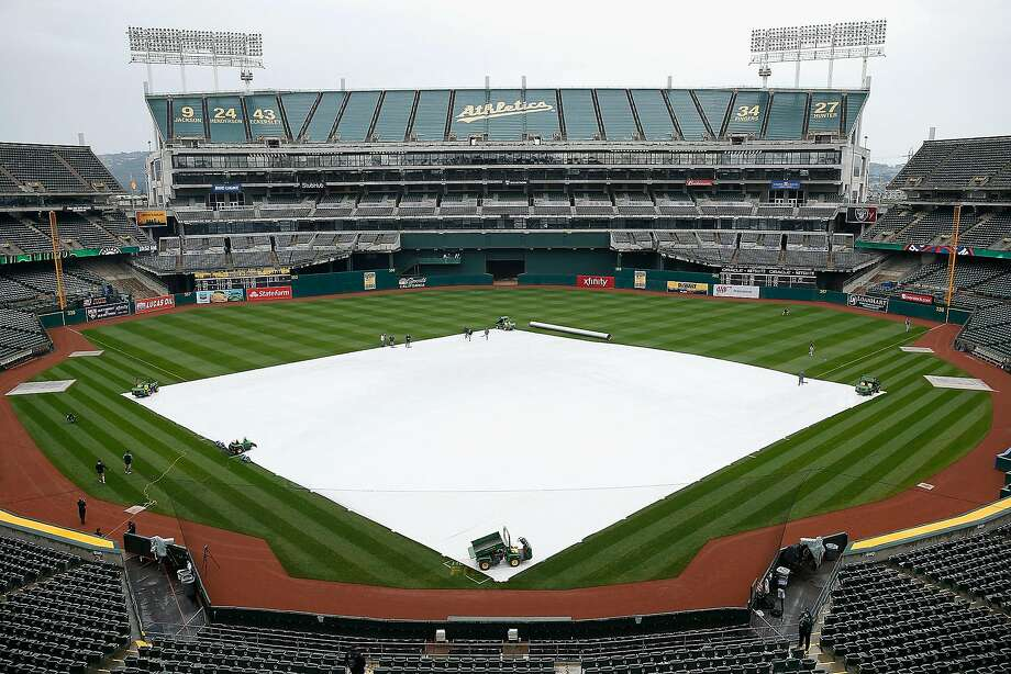 A tarp covers the infield as rain falls before the game between the  Houston Astros and the Oakland Athletics at Oakland Alameda Coliseum on April 16, 2017 in Oakland, California. The game was postponed to a future date do to the weather.  Photo: Lachlan Cunningham, Getty Images
