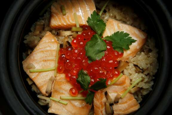Koshihikari rice with salmon and ikura (salmon roe) in a donabe at Yuzuki Japanese Eatery on Saturday, April 15, 2017, in San Francisco, Calif.