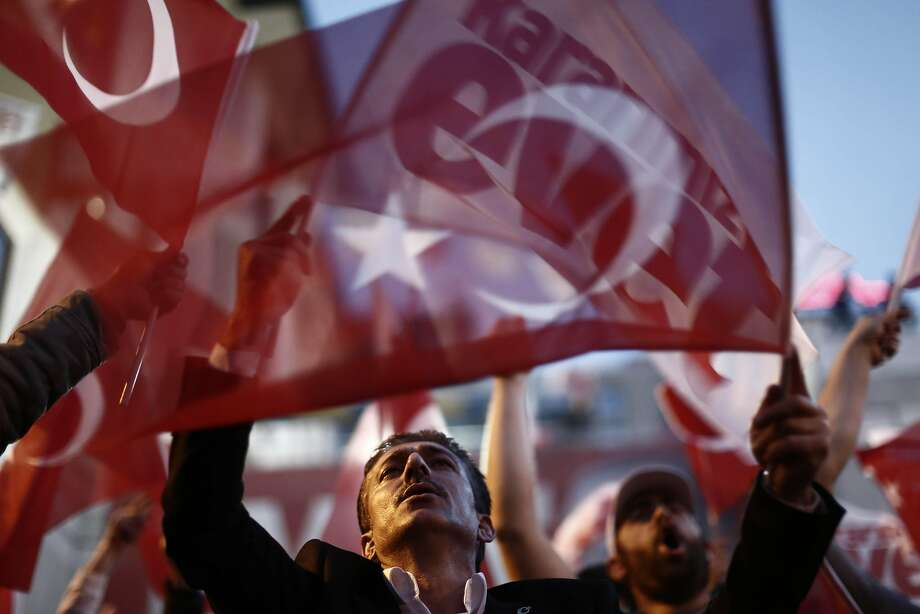 Residents wave 'Yes' and Turkish national flags outside of the AKP party headquarters as they react to the outcome of the referendum in Istanbul, Turkey, on Sunday, April 16, 2017. With a declared victory, Turks approved the most radical constitutional overhaul since the republic was founded 93 year ago, giving President Recep Tayyip Erdogan authority to appoint ministers and top judges at his discretion and call elections at any time. Photographer: Kostas Tsironis/Bloomberg Photo: Kostas Tsironis, Bloomberg