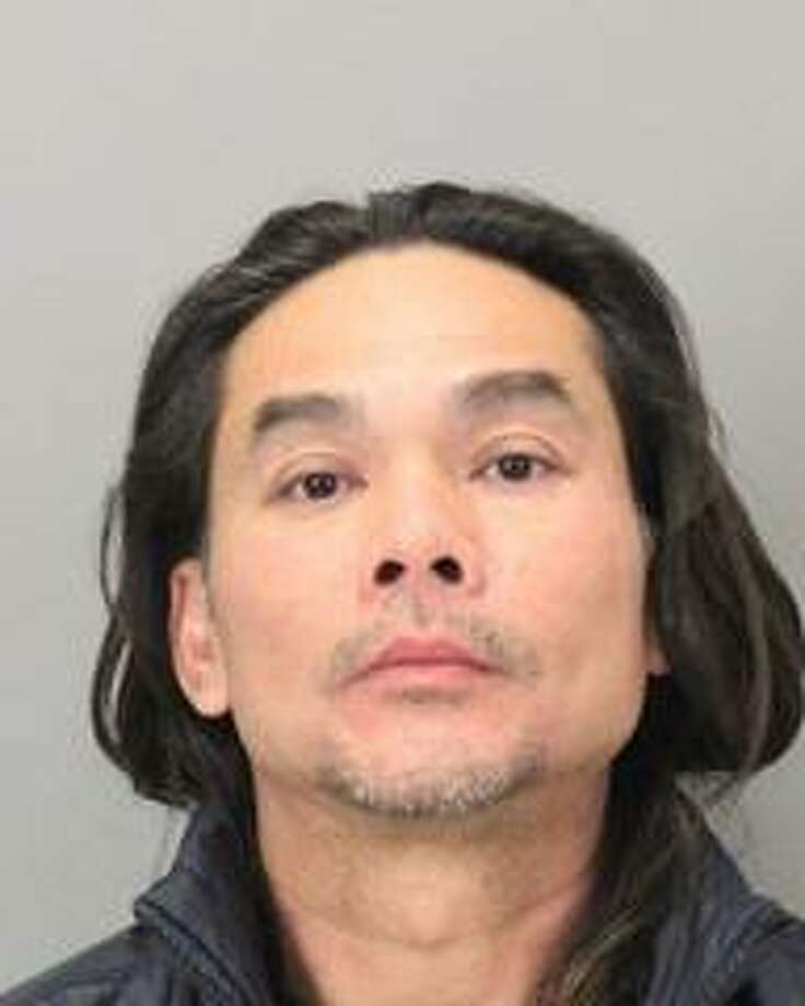 San Jose resident Patrick Van Lam, 45, was arrested Saturday after he turned himself in following the theft of a football signed by Jerry Rice from a charity auction in Milpitas, police said.