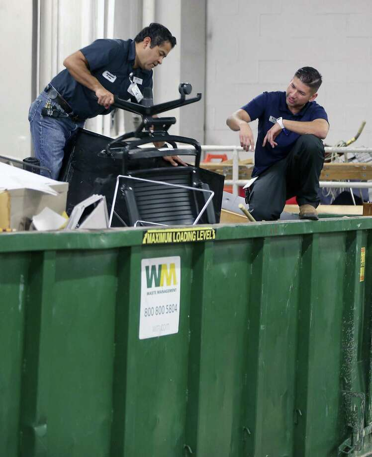 Eric Pena, right, works in the loading dock Thursday, April 13, 2017 at the San Antonio Public Library Main Branch with one of his facilities maintenance team members. Pena is interested in returning to college to finish his degree. He will likely participate in the new Upgrade program, a collaboration between the city and education nonprofits to provide services and counseling for adults looking to return to school. Photo: William Luther, Staff / San Antonio Express-News / © 2017 San Antonio Express-News