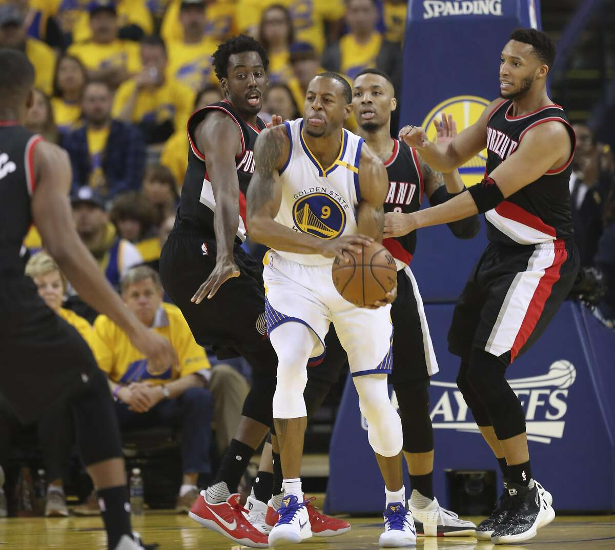 Golden State Warriors' Andre Iguodala is surrounded by Portland Trailblazers in the second quarter during Game 1 of the First Round of the Western Conference 2017 NBA Playoffs at Oracle Arena on Sunday, April 16, 2017 in Oakland, Calif.