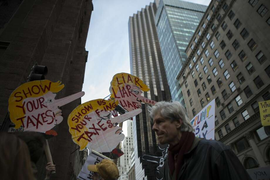 New York CityActivists take part in a Tax Day protest on April 15, 2017 in New York City. Thousands of activists march to Trump Tower to demand that President Donald Trump release his tax returns. Photo: VIEW Press/Corbis Via Getty Images