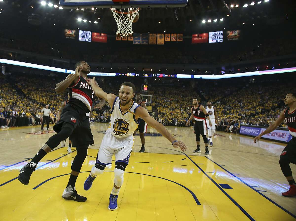 Golden State Warriors' Stephen Curry calls for a foul after going up for a layup during Game 1 of the First Round of the Western Conference 2017 NBA Playoffs at Oracle Arena on Sunday, April 16, 2017 in Oakland, Calif.