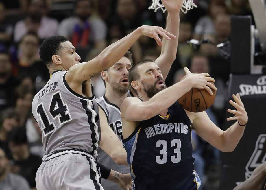 Memphis Grizzlies center Marc Gasol (33) is defended by San Antonio Spurs guard Danny Green (14) and center Pau Gasol during the second half in Game 1 of a first-round NBA basketball playoff series, Saturday, April 15, 2017, in San Antonio. San Antonio won 111-82. (AP Photo/Eric Gay) Photo: Eric Gay, STF / Associated Press / Copyright 2017 The Associated Press. All rights reserved.