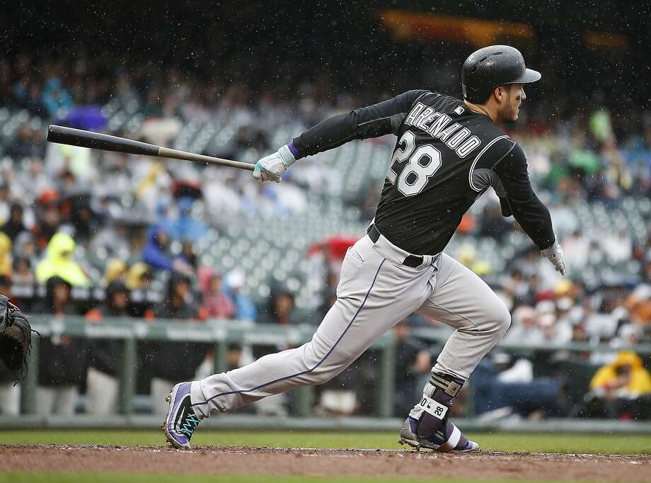 Giants-killer Nolan Arenado hits a two-run double in the first inning. Photo: Tony Avelar, Associated Press