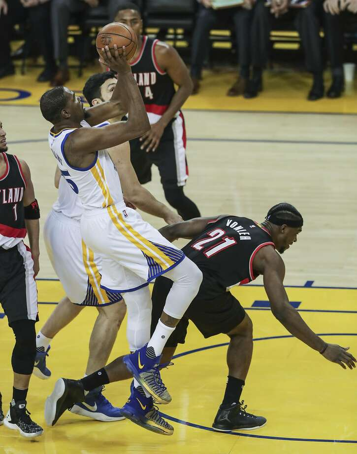 Golden State Warriors' Kevin Durant is fouled by Portland Trailblazers' Noah Vonleh in the first quarter during Game 1 of the First Round of the Western Conference 2017 NBA Playoffs at Oracle Arena on Sunday, April 16, 2017 in Oakland, Calif. Photo: Michael Macor, The Chronicle