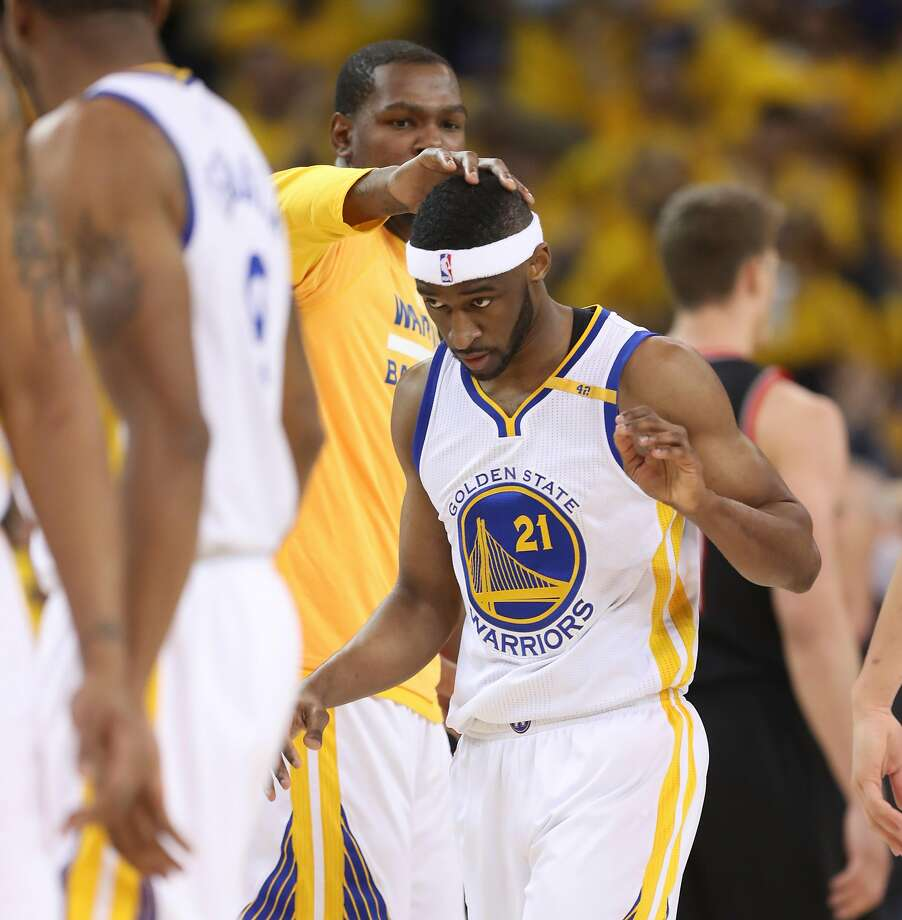 Golden State Warriors' Kevin Durant gives Ian Clark a head pat after he stole the ball and scored in the second quarter during Game 1 of the First Round of the Western Conference 2017 NBA Playoffs at Oracle Arena on Sunday, April 16, 2017 in Oakland, Calif. Photo: Scott Strazzante, The Chronicle